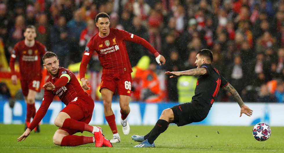 Soccer Football - Champions League - Round of 16 Second Leg - Liverpool v Atletico Madrid - Anfield, Liverpool, Britain - March 11, 2020  Liverpool's Jordan Henderson in action with Atletico Madrid's Angel Correa   REUTERS/Phil Noble
