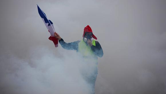 """""""Chalecos amarillos"""": policía de Francia llama a cerrar el sábado comercios en los Campos Elíseos por protestas. (AFP)."""