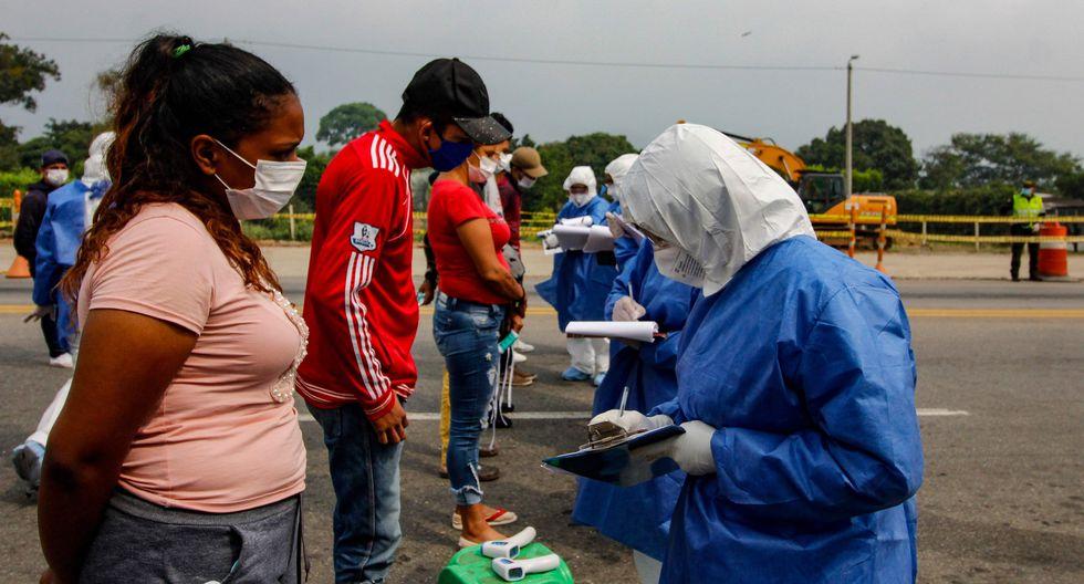 Trabajadores de Salud realizan controles en el Puente Internacional Simón Boliviar, en Cúcuta, frontera Colombia-Venezuela   Foto:  AFP / Schneyder MENDOZA