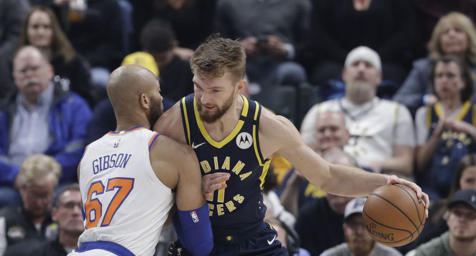Indiana Pacers' Domantas Sabonis (11) is defended by New York Knicks' Taj Gibson (67) during the first half of an NBA basketball game, Saturday, Feb. 1, 2020, in Indianapolis. (AP Photo/Darron Cummings)
