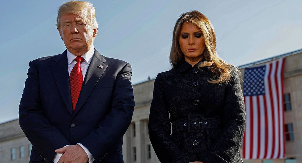 U.S. President Donald Trump and first lady Melania Trump bow their heads during the 9/11 observance at the National 9/11 Pentagon Memorial in Arlington, Virginia, U.S., September 11, 2017. REUTERS/Kevin Lamarque