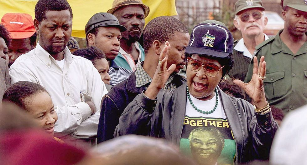 (FILES) In this file photo taken on April 21, 1999 Winnie Madikizela-Mandela of the African National Congress (ANC) addresses a crowd, in the Mnandi squattercamp some 20 km west of Pretoria.  Winnie Mandela, the ex-wife of South African anti-apartheid fighter and former president Nelson Mandela, died on April 2, 2018 in a Johannesburg hospital after a long illness at the age of 81, her spokesman Victor Dlamini said in a statement. / AFP / Odd ANDERSEN