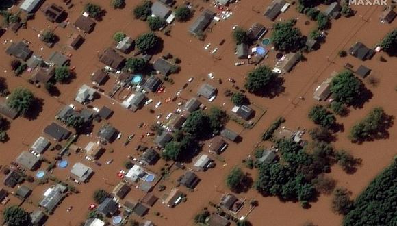 Una imagen de satélite distribuida por Maxar Technologies muestra viviendas inundadas en Manville, Nueva Jersey, el 2 de septiembre de 2021 tras el paso de los remanentes del huracán Ida. (EFE).
