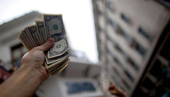 Dólar cierra la semana con nueva caída y se cotiza en S/3.459