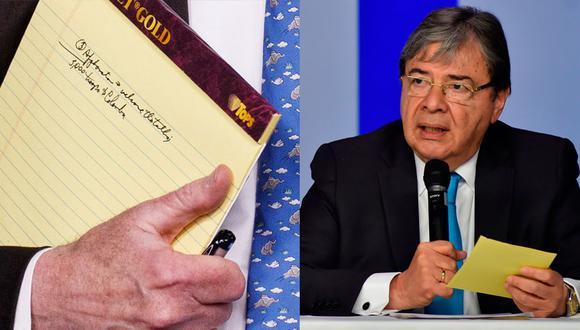 """El canciller de Colombia, Carlos Holmes Trujillo, dijo que el Gobierno de su país """"desconoce el alcance y la razón"""" de la anotación """"5.000 tropas a Colombia"""" en el cuaderno de John Bolton. (AP/Reuters)"""