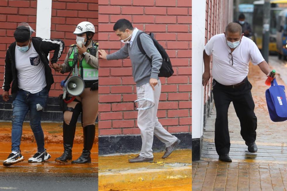 Peatones que se encuentran por el kilómetro 7 de la Panamericana Sur presentan dificultades debido al derrame de aceite crudo de palma a la altura del Puente Vivanco, en el distrito de Surco. (Foto: Britanie Arroyo / @photo.gec)