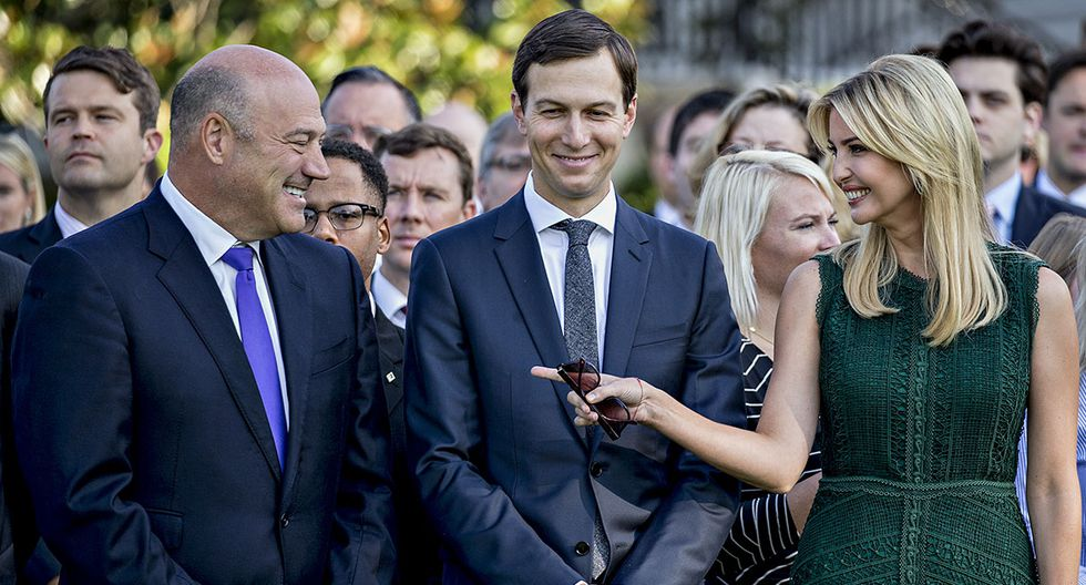 Gary Cohn, director of the U.S. National Economic Council, left, speaks with Ivanka Trump, assistant to U.S. President Donald Trump, right, and Jared Kushner, senior White House adviser, before a moment of silence with U.S. President Donald Trump, not pictured, in remembrance of those lost during the September 11, 2001 terrorist attacks, on the South Lawn of the White House in Washington, D.C., U.S., on Monday, Sept. 11, 2017. Trump is presiding over his first 9/11 commemoration on the 16th anniversary of the terrorist attacks that killed nearly 3,000 people when hijackers flew commercial airplanes into New York's World Trade Center, the Pentagon and a field near Shanksville, Pennsylvania. Photographer: Andrew Harrer/Bloomberg