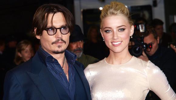 Amber Heard y Johnny Depp. Tras 15 meses juntos, el matrimonio terminó con denuncias de maltrato físico contra Depp y una foto en la que Heard mostraba su rostro golpeado. Depp negó las acusaciones, pero afrontó una millonaria compensación. (Foto: AFP)