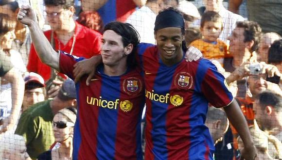 Sandro Rosell, ex presidente del Barcelona, afirmó que Ronaldinho superó a Leo Messi un par de temporadas. (Foto: AFP)