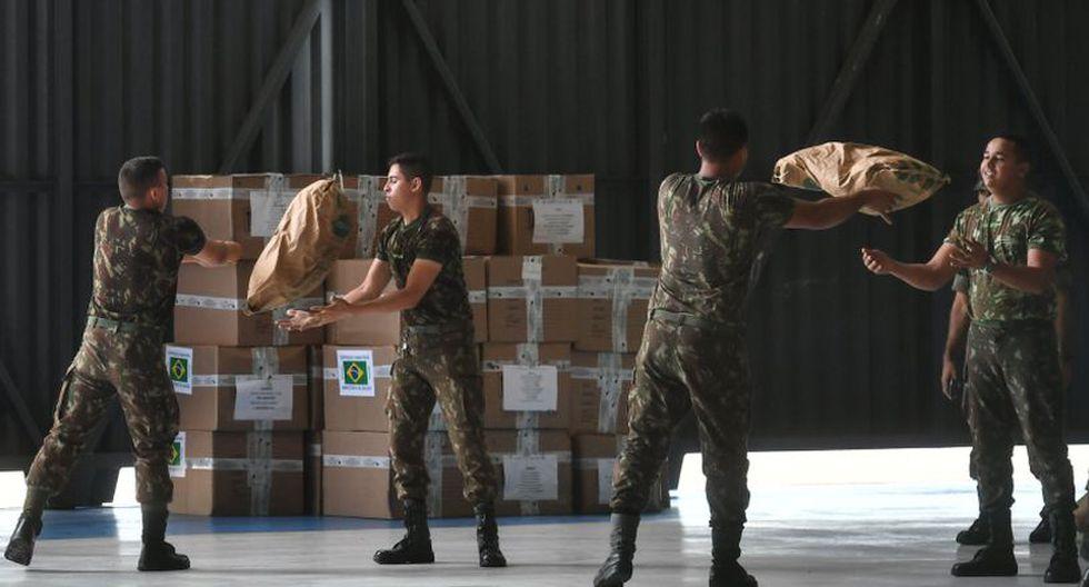 """El gobierno de Brasil se ha comprometido con la operación, pero ha establecido como única condición que esa carga sea transportada por """"camiones venezolanos con conductores venezolanos"""". (Foto: AFP)"""