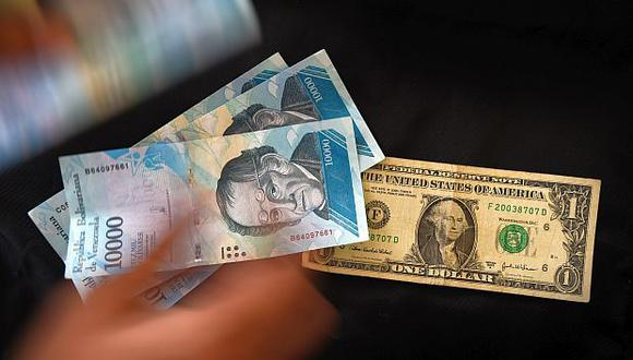 El precio del dólar en Venezuela operaba al alza este viernes 25 de septiembre, según el portal DolarToday. (Foto: AFP)