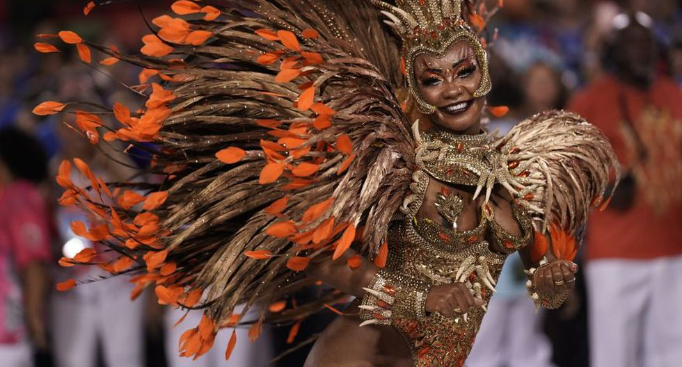 A performer from the Viradouro samba school parades during Carnival celebrations at the Sambadrome in Rio de Janeiro, Brazil, Sunday, Feb. 23, 2020. (AP Photo/Leo Correa)