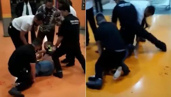 Según la policía local el hombre habría amenazado a una trabajadora del supermercado, quien habría llamado a los agentes de seguridad, que le propinaron la paliza a la salida del centro. (Foto: Captura YouTube).