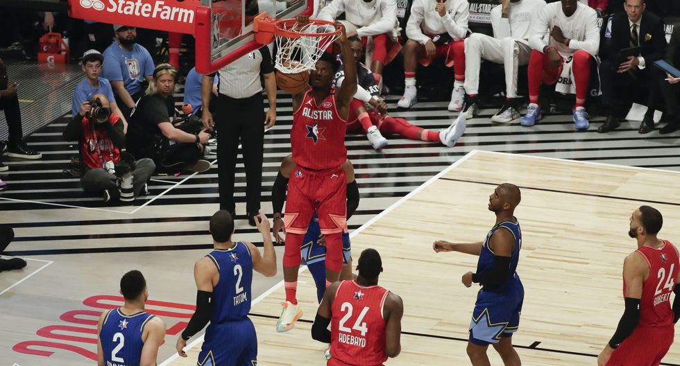 Jimmy Butler of the Miami Heat dunks during the first half of the NBA All-Star basketball game Sunday, Feb. 16, 2020, in Chicago. (AP Photo/David Banks)