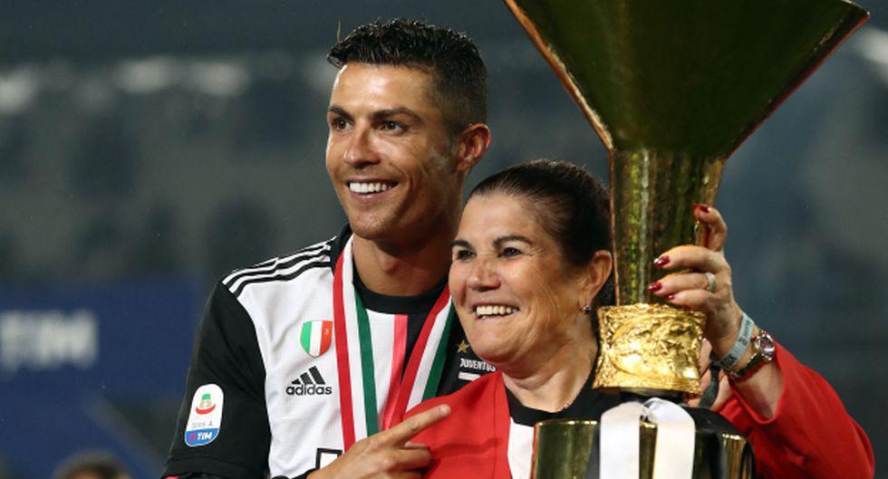 Cristiano Ronaldo y Dolores Aveiro. (Foto: AFP)