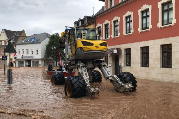 The rescue boat is being transported by a special vehicle to the flooded Ehrong area of Trier in West Germany.  (AFP).