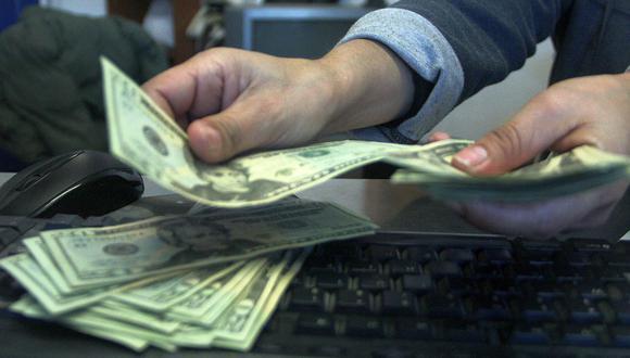 El dólar cerró a S/3,52 en el mercado interbancario el jueves. (Foto: AFP)