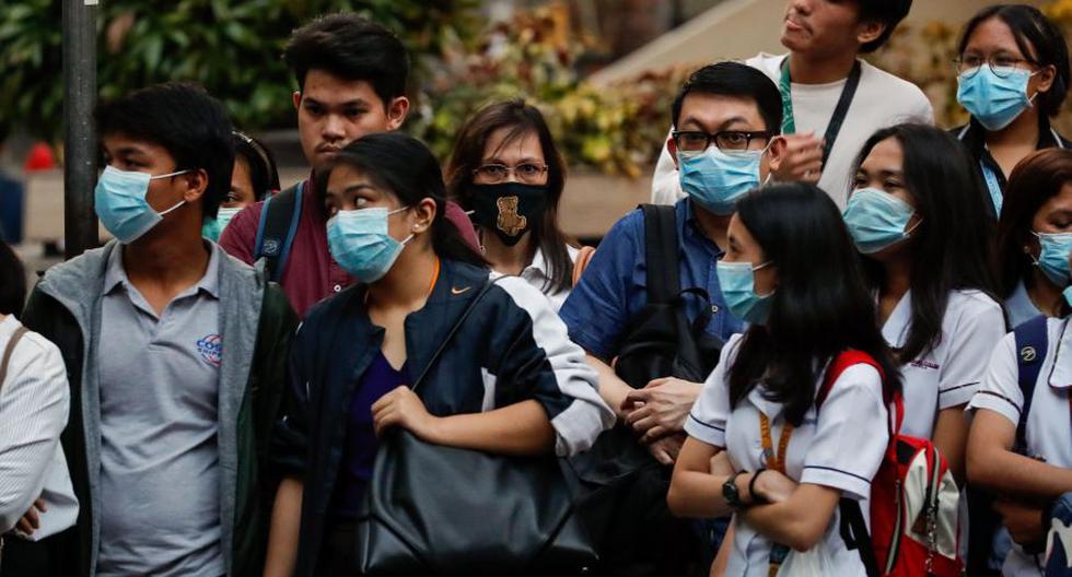 Ciudadanos filipinos usan máscaras para protegerse contra la propagación del Coronavirus. (Foto: EFE).