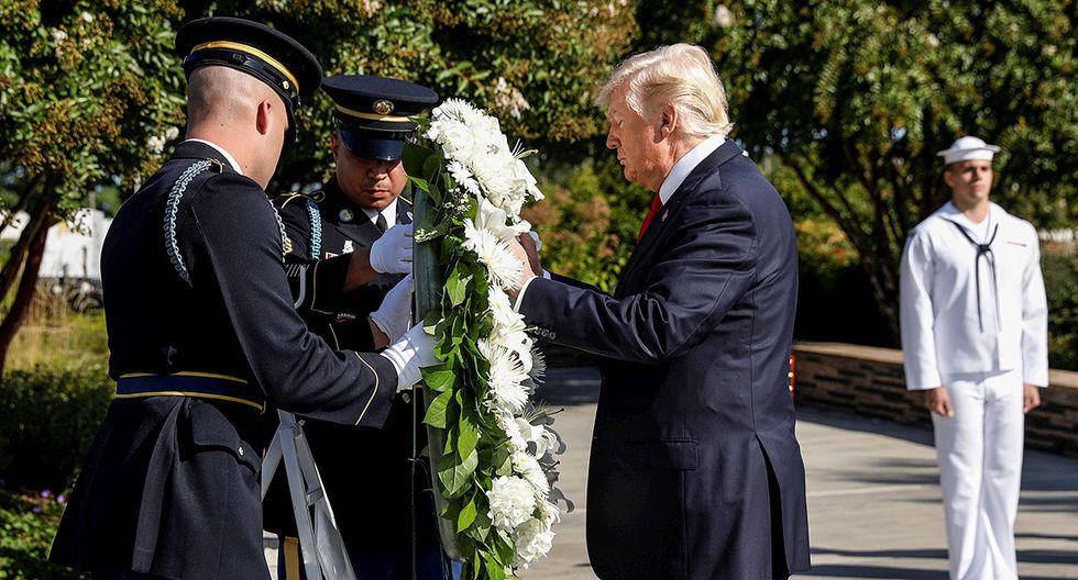 U.S. President Donald Trump lays a wreath during the 9/11 observance at the National 9/11 Pentagon Memorial in Arlington, Virginia, U.S., September 11, 2017. REUTERS/Kevin Lamarque