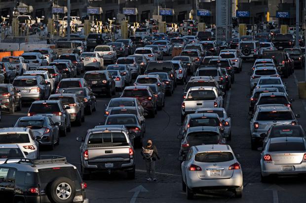 Passengers line up to enter the United States on October 13, 2021 in San Jitro, Tijuana, Baja California, Mexico.