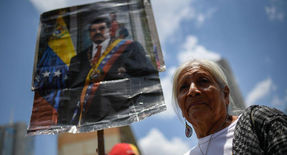 Miles de chavistas se concentraron en Caracas para celebrar el primer año de la reelección de Nicolás Maduro. (AFP).