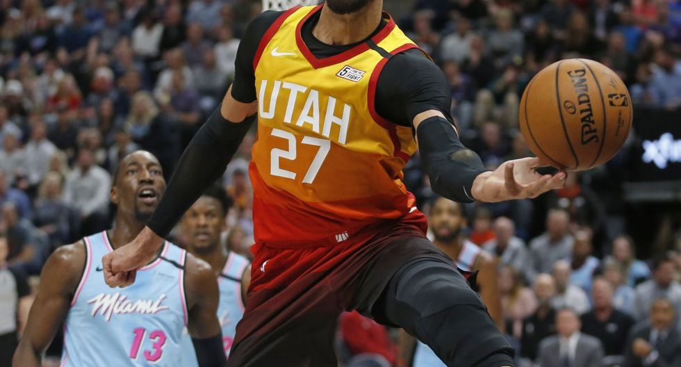 Utah Jazz center Rudy Gobert (27) goes after a rebound as Miami Heat forward Bam Adebayo (13) looks on in the second half of an NBA basketball game Wednesday, Feb. 12, 2020, in Salt Lake City. (AP Photo/Rick Bowmer)