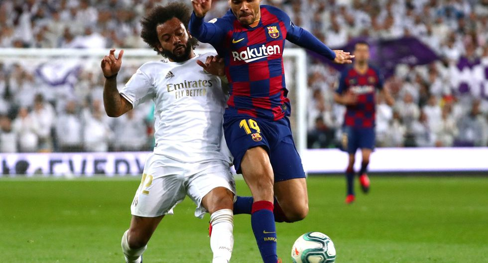 Soccer Football - La Liga Santander - Real Madrid v Barcelona - Santiago Bernabeu, Madrid, Spain - March 1, 2020  Barcelona's Martin Braithwaite in action with Real Madrid's Marcelo   REUTERS/Sergio Perez
