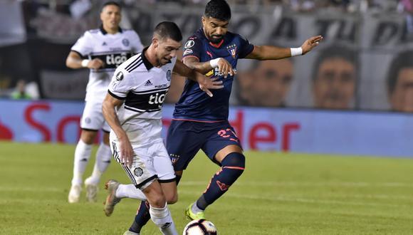 Liga de Quito certificó su pase a los cuartos de final de la Copa Libertadores con un valioso empate por 1-1 ante Olimpia. (Foto: AFP)
