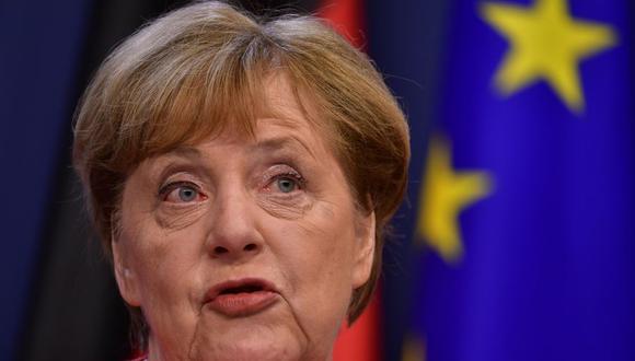 Coronavirus: La canciller alemana Angela Merkel habla durante una conferencia de prensa conjunta con el presidente francés Emmanuel Macron al final de la cumbre de la Unión Europea en Bruselas. (Foto: JOHN THYS / POOL / AFP).