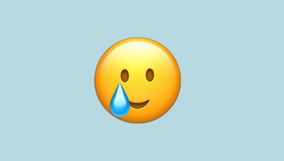 Conoce realmente qué significa el emoji de la cara sonriente con una lágrima en WhatsApp. (Foto: Emojipedia)