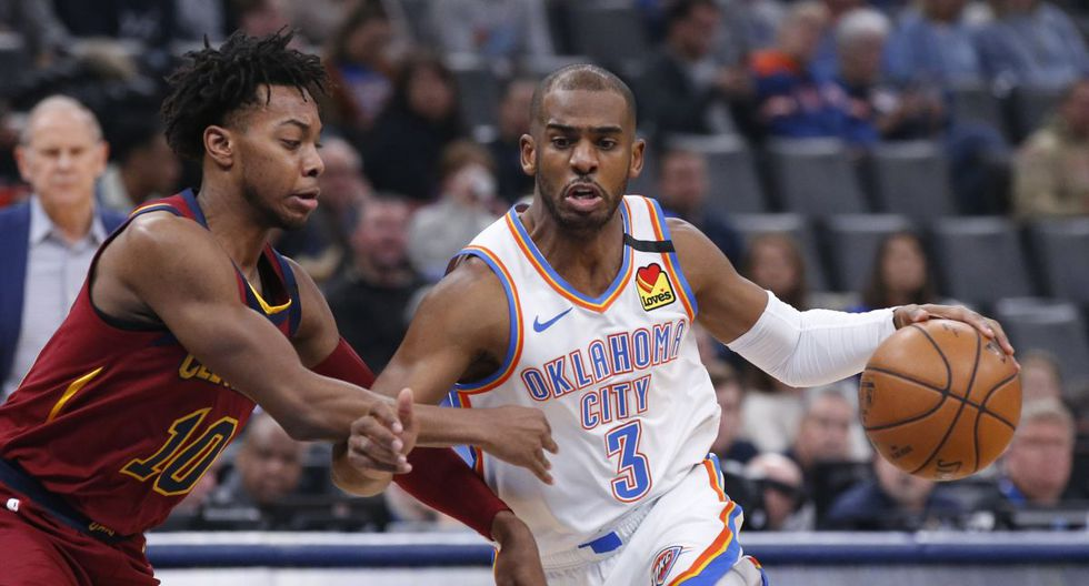 Oklahoma City Thunder guard Chris Paul (3) drives around Cleveland Cavaliers guard Darius Garland during the first half of an NBA basketball game Wednesday, Feb. 5, 2020, in Oklahoma City. (AP Photo/Sue Ogrocki)