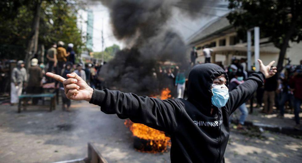 Los enfrentamientos, que duraron hasta las primeras horas del día, han cesado temporalmente, aunque están previstas nuevas manifestaciones a lo largo de la jornada en la capital. (Foto: EFE)