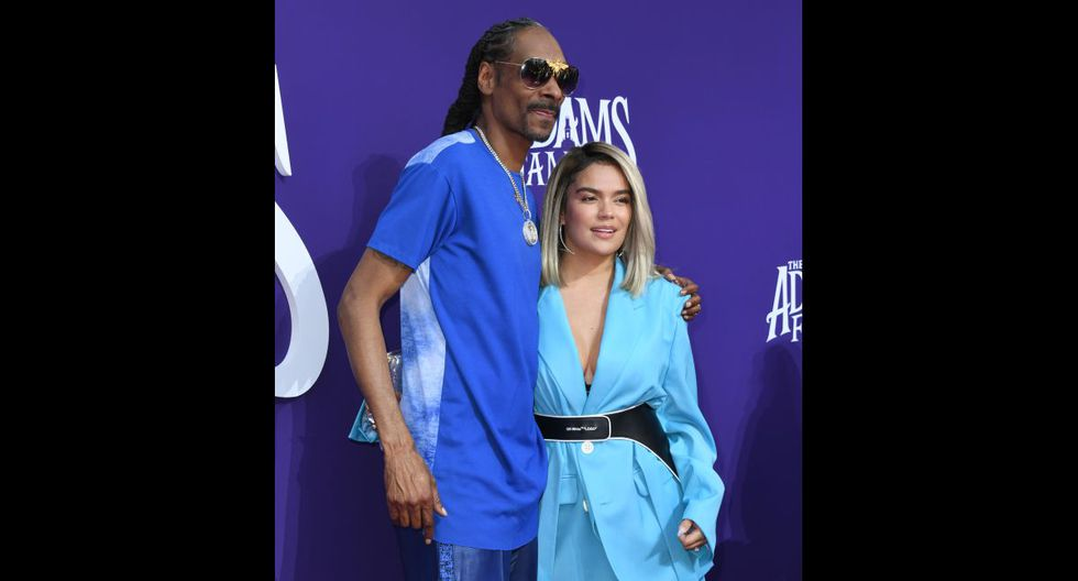 """LOS ANGELES, CALIFORNIA - OCTOBER 06: Snoop Dogg and Karol G attend the premiere of MGM's """"The Addams Family"""" at Westfield Century City AMC on October 06, 2019 in Los Angeles, California.   Jon Kopaloff/Getty Images,/AFP"""