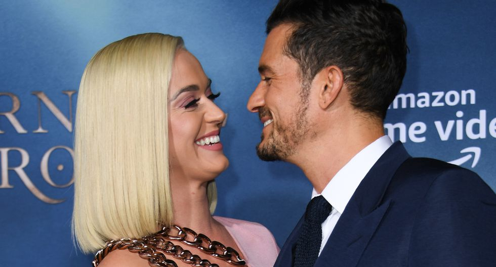 """British actor Orlando Bloom and US singer/songwriter Katy Perry arrive for the Los Angeles premiere of Amazon Original Series """"Carnival Row"""" at the TCL Chinese theatre on August 21, 2019 in Hollywood. (Photo by VALERIE MACON / AFP) / ALTERNATIVE CROP"""