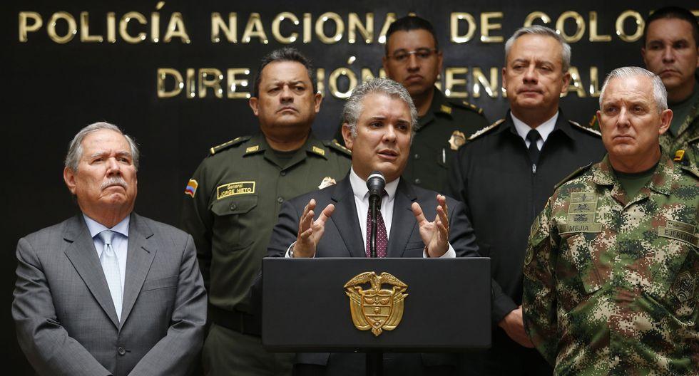 El ministro de Defensa Guillermo Botero (izquierda) junto al presidente Iván Duque (centro). (Foto: AFP).