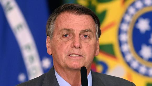 El presidente brasileño, Jair Bolsonaro, durante una conferencia de prensa para el lanzamiento del Sistema de Integridad Pública, destinado a combatir la corrupción en el gobierno federal, en el Palacio Planalto en Brasilia. (Foto: EVARISTO SA / AFP).