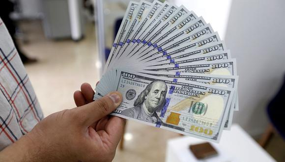 El dólar se cotizaba en 19,8338 pesos en México este viernes. (Foto: AFP)
