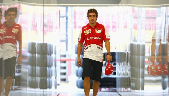 SINGAPORE - SEPTEMBER 19:  Fernando Alonso of Spain and Ferrari walks out of the team garage during previews for the Singapore Formula One Grand Prix at Marina Bay Street Circuit on September 19, 2013 in Singapore, Singapore.  (Photo by Paul Gilham/Getty