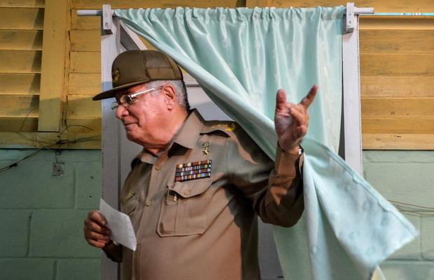In this file photo taken on April 19, 2015, the then Deputy Minister of the Cuban Army, Alvaro Lopez Mierra, casts his vote at an election college in the nautical neighborhood of Havana.  (Photo by Atalberto ROQUE / AFP).