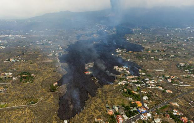 Lava flows from the volcanic eruption, destroying homes on the island of La Palma on Tuesday, September 21, 2021 in the Canary Islands, Spain.  (AB Photo / Emilio Morenatti).