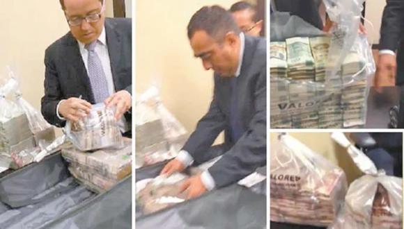 En el video, publicado originalmente en YouTube el 16 de agosto pasado, se observa a dos exfuncionarios del Senado vinculados al opositor PAN, recibiendo fajos de billetes para después introducirlos en maletas negras. (Captura de video El Universal de México, GDA).