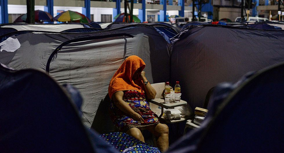 REFILE - QUALITY REPEAT   A woman, displaced by flash floods caused by monsoon rains, sits on a chair at an evacuation center in Marikina, Metro Manila, in Philippines, August 13, 2018. REUTERS/Eloisa Lopez