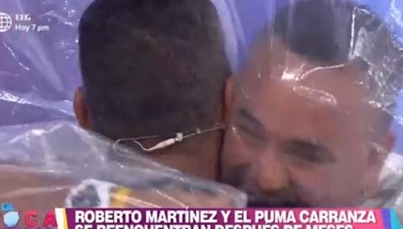 """'Puma' Carranza y Roberto Martínez protagonizaron emotivo abrazo en el programa """"En boca de todos"""". (Foto: Captura América TV)"""