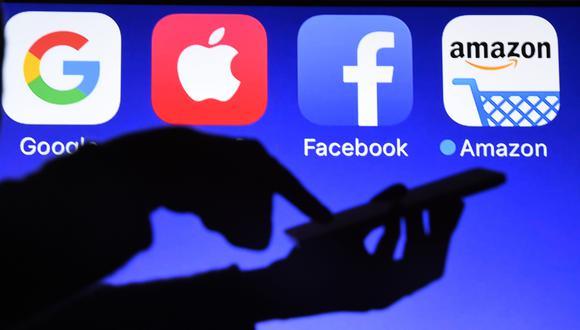 Las gigantes tecnológicas generan millones de dólares gracias a su posicionamiento y dependencia generada en los usuarios.  AFP / Damien MEYER