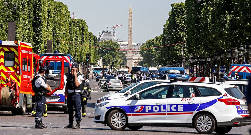 French policemen and firefighters secure the area on the Champs Elysees avenue after an incident in Paris, France, June 19, 2017. REUTERS/Gonzalo Fuentes