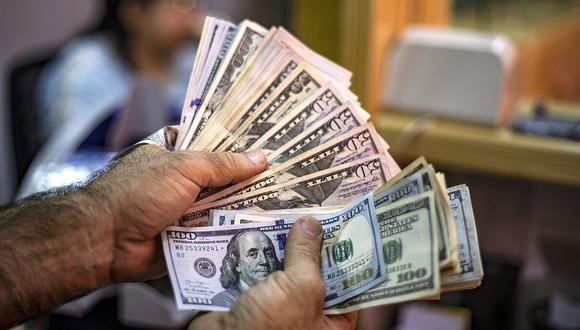 En el mercado paralelo o casas de cambio de Lima, el tipo de cambio se cotizaba a S/3,610 la compra y S/3,650 la venta. (Foto: AFP)