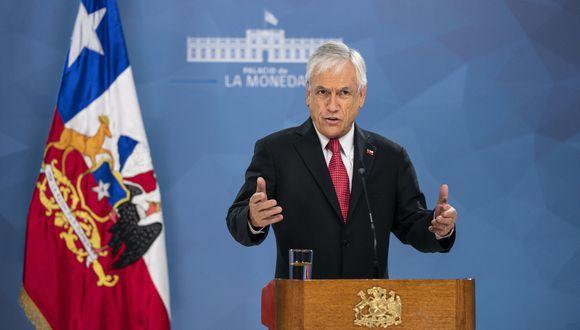 """""""La clase media es el orgullo de nuestro país, ha progresado en base a su propio mérito y esfuerzo. Y hoy, debido a los tiempos de adversidad, está enfrentando grandes amenazas y temores"""", aseguró el presidente chileno Sebastián Piñera. (AFP)."""