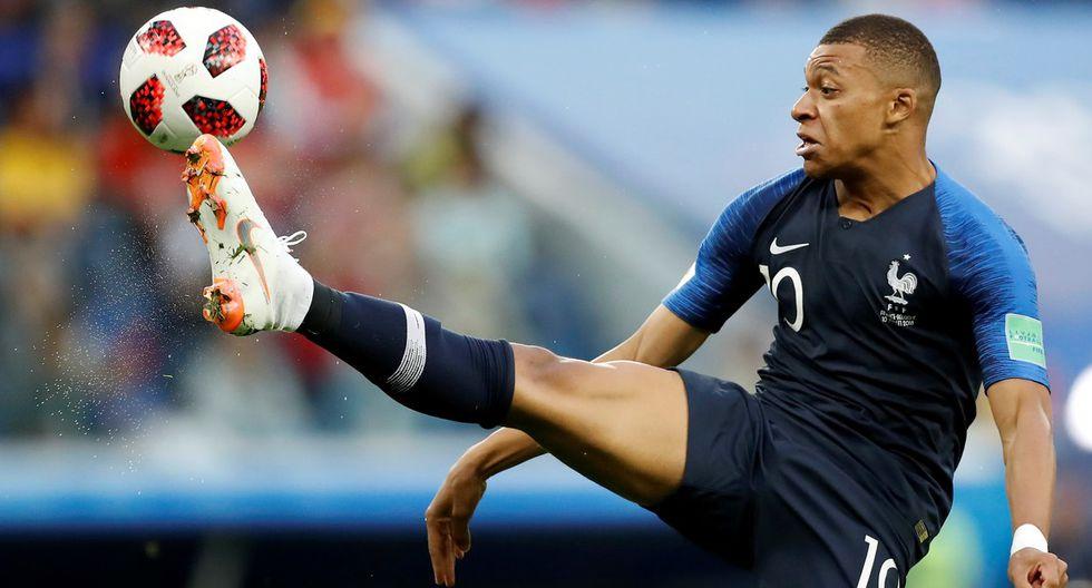 Kylian Mbappé superó a Antoine Griezmann y Raphael Varane, sus compañeros en la selección de Francia, para llevarse la distinción otorgada por la revista France Football. (Foto: AP)