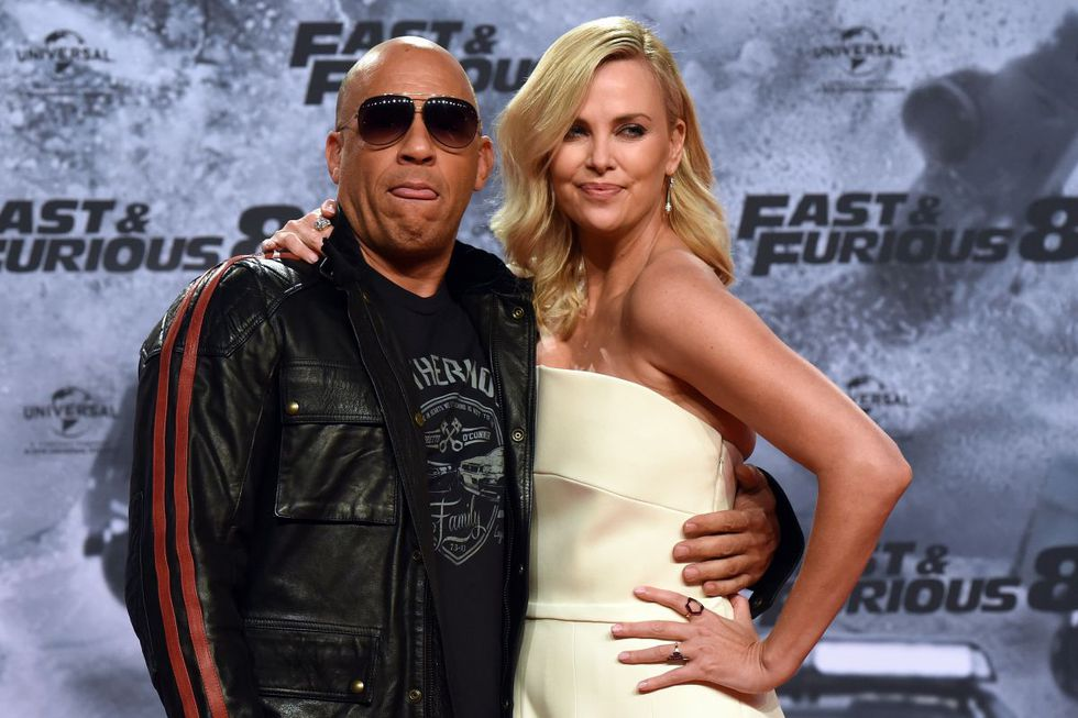 The actress south african Charlize Theron and american actor Vin Diesel striking a pose on the red carpet when they arrive for the premiere of the movie Fast and Furious 8 in Berlin on 4 April 2017 (Photo: Maurizio Gambarini / DPA / AFP)