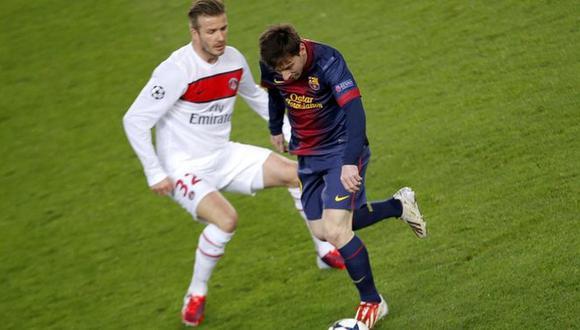 David Beckham y Lionel Messi en un duelo entre el PSG y Barcelona. (Foto: AFP)